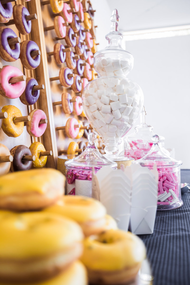 Donut Wall Dessert Table with Jars of Lollies and Marshmallows